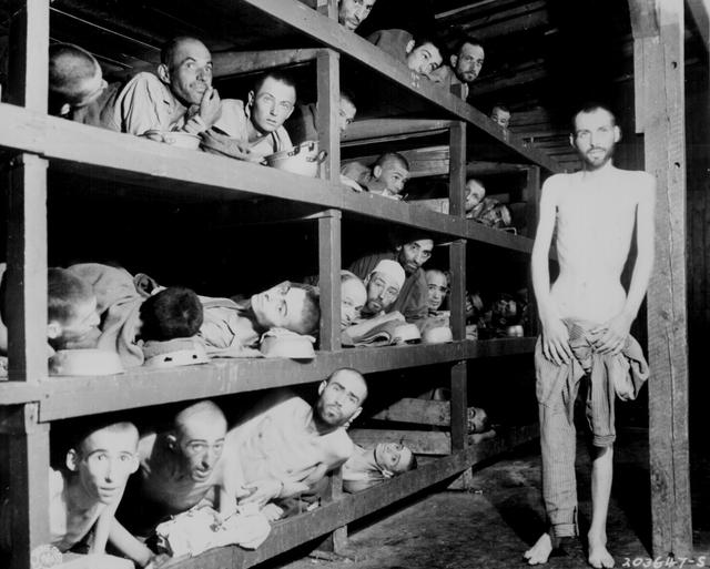 Slave laborers in the Buchenwald concentration camp in Germany are pictured after U.S. soldiers of the 80th Division entered the camp, April 16, 1945. U.S. National Archives/via REUTERS
