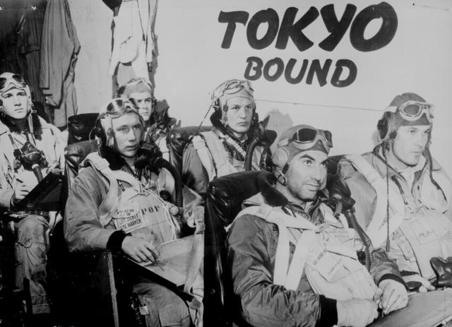 Pilots aboard a U.S. Navy aircraft carrier receive last minute instructions before taking off to attack industrial, and military installations in Tokyo, February 17, 1945. U.S. National Archives/via REUTERS
