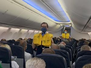 FILE PHOTO: Flight attendants at first tourist flight from Germany to the...