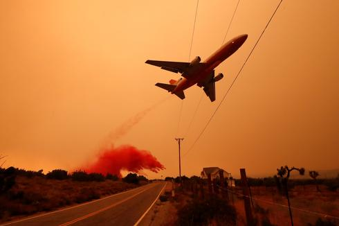 California's ember skies glow from wildfires