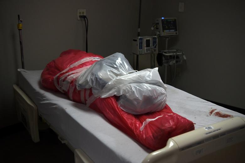 A man who died from COVID-19 is wrapped in a body bag at the United Memorial Medical Center's coronavirus intensive care unit in Houston, Texas, June 29. REUTERS/Callaghan O'Hare