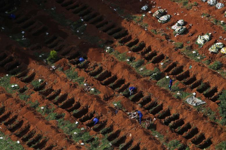 Gravediggers open new graves as the number of dead rose amid the coronavirus outbreak, at Vila Formosa cemetery, Brazil's biggest cemetery, in Sao Paulo, April 2. REUTERS/Amanda Perobelli