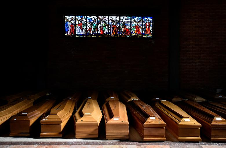 Coffins of people who have died from coronavirus are seen in the church of the Serravalle Scrivia cemetery in Alessandria, Italy, March 23. REUTERS/Flavio Lo Scalzo