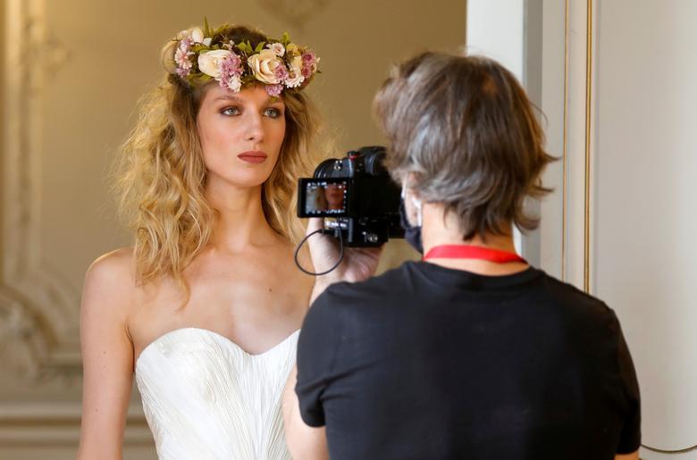 French model Tiffany Fournier poses for a digital presentation for La Metamorphose. REUTERS/Charles Platiau