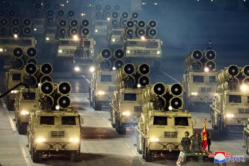 North Korea shows off military might in nighttime parade