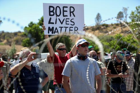 South African white farmers, rival Black protesters face off over farm murder case