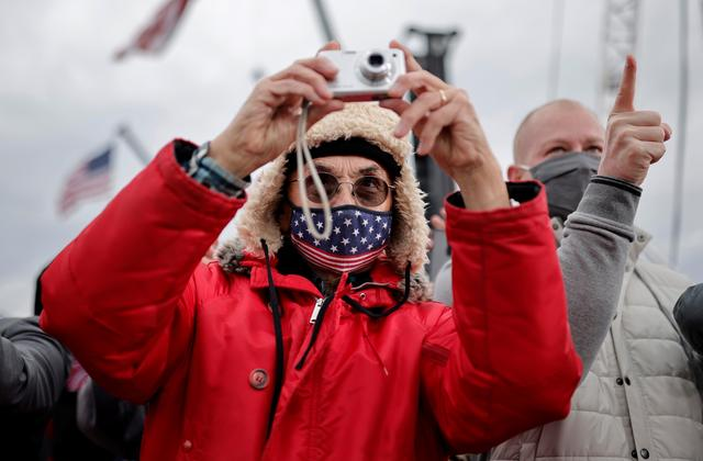 A person takes a picture  as U.S. President Donald Trump attends a campaign rally at Muskegon County Airport in Muskegon, Michigan U.S., October 17, 2020. REUTERS/Carlos Barria