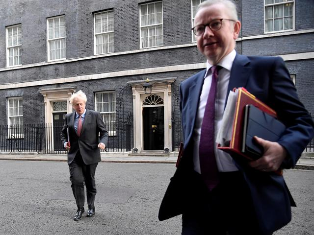 FILE PHOTO: Britain's Prime Minister Boris Johnson and Britain's Chancellor of the Duchy of Lancaster Michael Gove walk outside Downing Street in London, Britain, September 30, 2020. REUTERS/Toby Melville