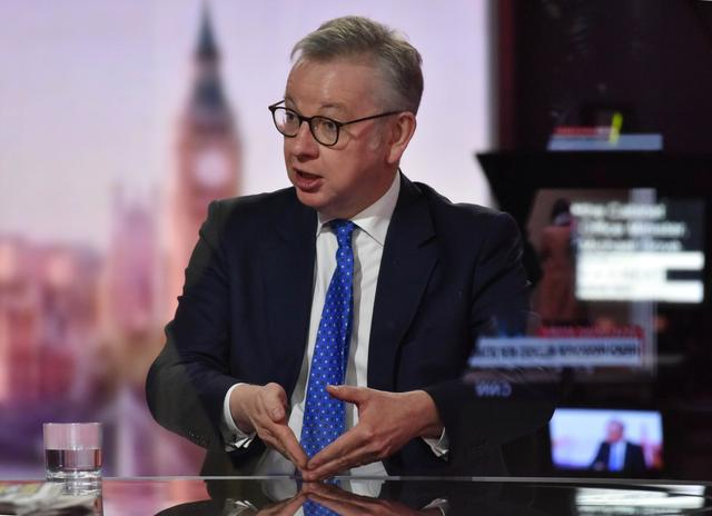 Britain's Chancellor of the Duchy of Lancaster Michael Gove appears on BBC TV's The Andrew Marr Show in London, Britain October 18, 2020. Picture taken through glass. Jeff Overs/BBC/Handout via REUTERS THIS IMAGE HAS BEEN SUPPLIED BY A THIRD PARTY. NO RESALES. NO ARCHIVES. NO NEW USES 21 DAYS OF ISSUE