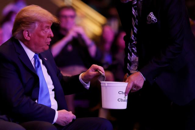 U.S. President Donald Trump donates money as he attends a mass at the International Church of Las Vegas in Las Vegas, Nevada, U.S., October 18, 2020. REUTERS/Carlos Barria