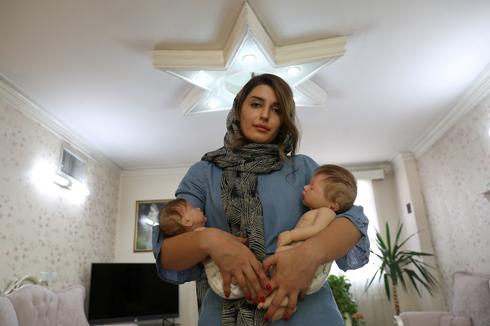 Life-like dolls act as surrogate children for some Iranian families