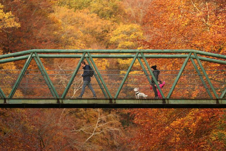 People walk on a bridge over river Garry, Pitlochry, Scotland, Britain October 23, 2020. REUTERS/Russell Cheyne