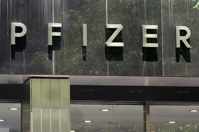 FILE PHOTO: A Pfizer sign is pictured at their Headquarters in the Manhattan borough of New York City, New York, U.S., July 22, 2020. REUTERS/Carlo Allegri/File Photo
