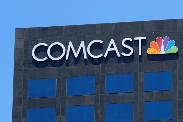 FILE PHOTO: The Comcast NBC logo is shown on a building in Los Angeles, California, U.S. June 13, 2018.        REUTERS/Mike Blake