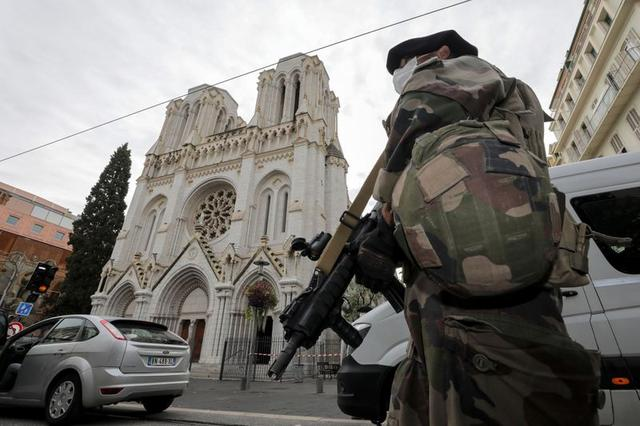 A French soldier stands in front of Notre-Dame church, where a knife attack took place, in Nice, France October 29, 2020. REUTERS/Eric Gaillard/Pool