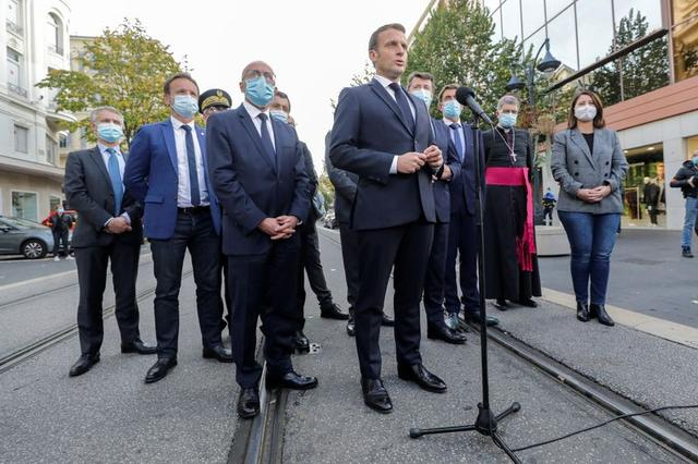 French President Emmanuel Macron speaks to the media during the visit to the scene of a knife attack at Notre Dame church in Nice, France October 29, 2020. REUTERS/Eric Gaillard/Pool