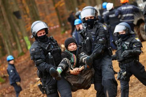 Protesters block A49 highway construction in German forest