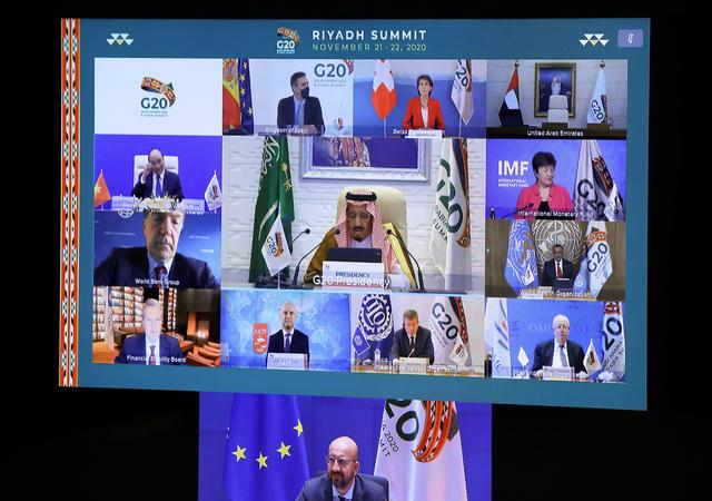 European Council President Charles Michel, Saudi Arabia's King Salman bin Abdulaziz Al Saud and other leaders are seen on a screen before the start of the virtual G20 meeting hosted by Saudi Arabia, amid the coronavirus disease (COVID-19) outbreak, in Brussels, Belgium November 21, 2020. REUTERS/Yves Herman/Pool