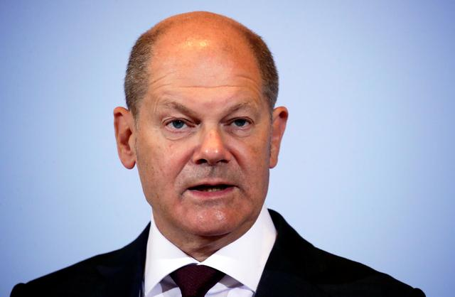 FILE PHOTO: German Finance Minister Olaf Scholz attends a joint news conference with Justice Minister Christine Lambrecht in Berlin, Germany, October 7, 2020. REUTERS/Hannibal Hanschke