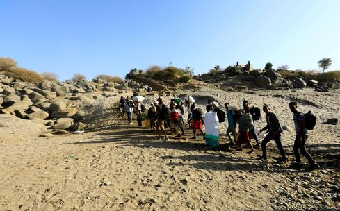 Thousands flee fighting in Ethiopia, cross border to Sudan