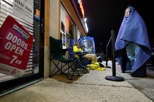 Pandemic fears and online deals thin Black Friday crowds