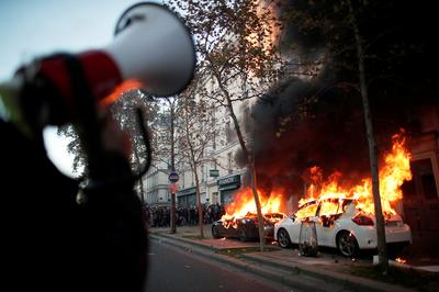 Clashes erupt at protest against police violence in Paris