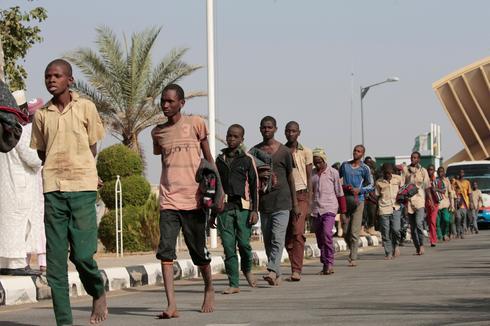 Freed Nigerian schoolboys return home