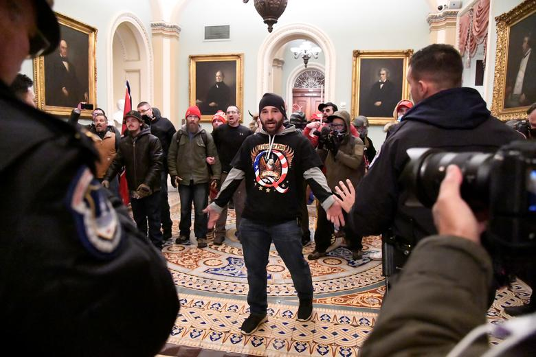 A supporter of President Trump confronts police on the second floor of the Capitol Building, January 6.         REUTERS/Mike Theiler