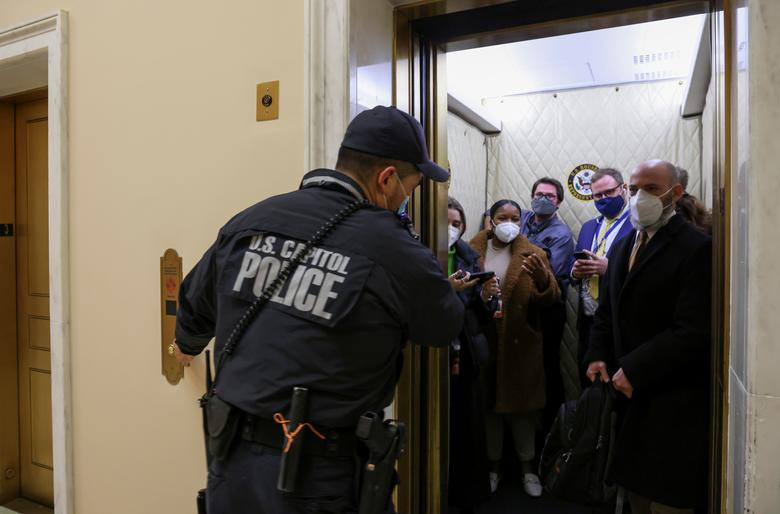 U.S. Capitol Police evacuate journalists and House press staff members from the Capitol to a connected office building, January 6. REUTERS/Jonathan Ernst