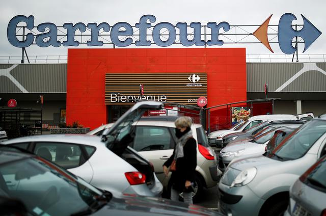 A customer is seen in front of a Carrefour hypermarket store in Carquefou near Nantes, France January 13, 2021. REUTERS/Stephane Mahe