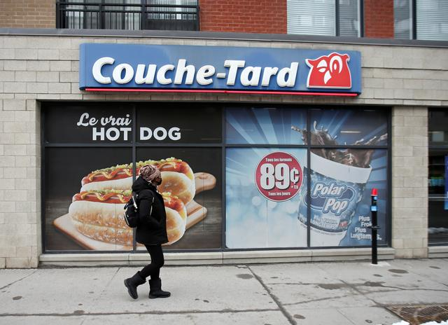 A pedestrian walks past a Couche-Tard convenience store  in Montreal, Quebec, Canada January 13, 2021.  REUTERS/Christinne Muschi