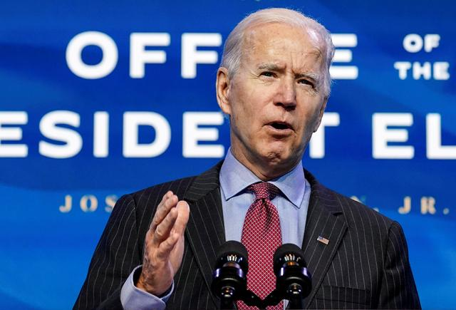 FILE PHOTO: U.S. President-elect Joe Biden speaks as he announces members of economics and jobs team at his transition headquarters in Wilmington, Delaware, U.S., January 8, 2021. REUTERS/Kevin Lamarque/File Photo