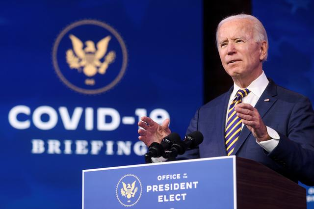 FILE PHOTO: U.S. President-elect Joe Biden delivers remarks on the U.S. response to the coronavirus disease (COVID-19) outbreak, at his transition headquarters in Wilmington, Delaware, U.S., December 29, 2020. REUTERS/Jonathan Ernst/File Photo