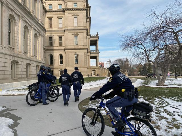 Michigan State police officers patrol the grounds of the state Capitol  in Lansing, Michigan, U.S. January 13, 2021, the first day the state legislature was back in session since the open carry of firearms was banned in the building.  REUTERS/Michael Martina