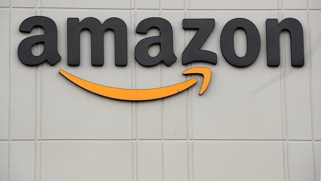 FILE PHOTO: The Amazon logo is pictured outside the company's JFK8 distribution center in Staten Island, New York, U.S. November 25, 2020.  REUTERS/Brendan McDermid./File Photo