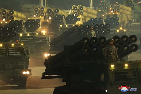 North Korea shows off military might in massive parade