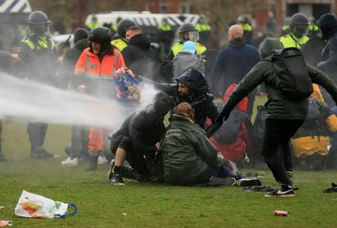 Dutch police detain hundreds as anti-lockdown protests turn violent