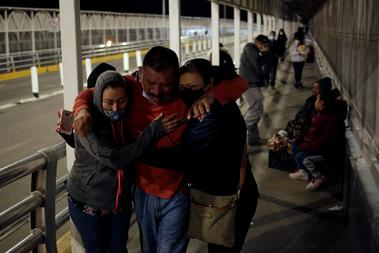 Ortega cries whilst meeting with his family after being deported from U.S....