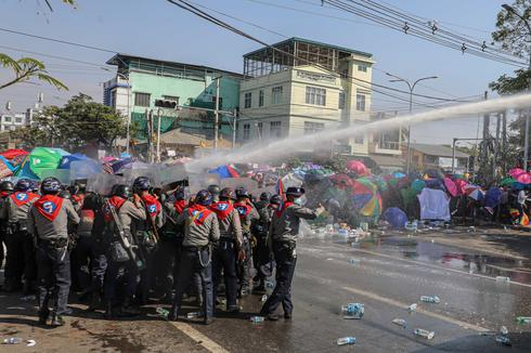 Myanmar police fire to disperse protest as demonstrations spread