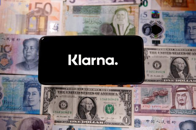FILE PHOTO: A smartphone displays a Klarna logo on top of banknotes is in this illustration taken January 6, 2020. REUTERS/Dado Ruvic/Illustration