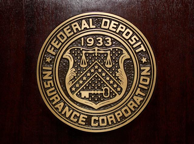FILE PHOTO: The Federal Deposit Insurance Corp (FDIC) logo is seen at the FDIC headquarters in Washington, February 23, 2011. REUTERS/Jason Reed/File Photo
