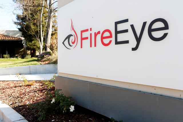 FILE PHOTO: The FireEye logo is seen outside the company's offices in Milpitas, California, December 29, 2014. FireEye is the security firm hired by Sony to investigate last month's cyberattack against Sony Pictures. Picture taken December 29.     REUTERS/Beck Diefenbach