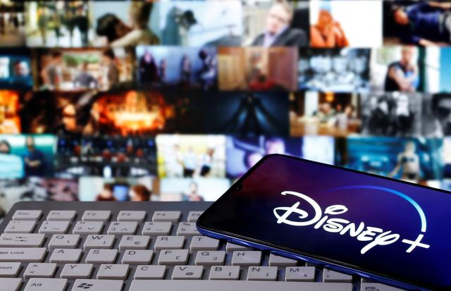 FILE PHOTO: A smartphone with displayed ''Disney'' logo is seen on the keyboard in this illustration taken March 24, 2020. REUTERS/Dado Ruvic
