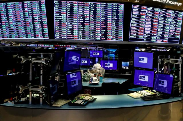 FILE PHOTO: Dividers are seen inside a trading post on the trading floor as preparations are made for the return to trading at the New York Stock Exchange (NYSE) in New York, U.S., May 22, 2020. REUTERS/Brendan McDermid