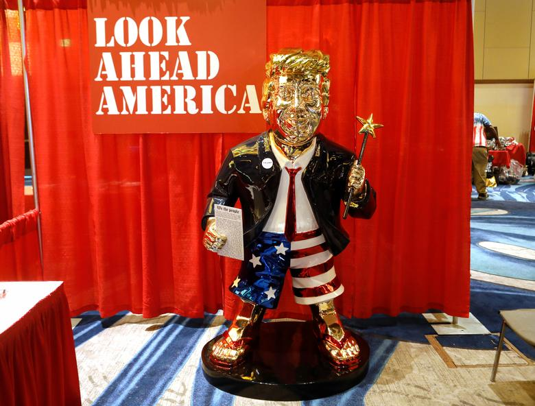 A gold-colored statue of former President Donald Trump, dressed in a jacket, red tie and Stars-and-Stripes boxing shorts, is displayed at the Conservative Political Action Conference (CPAC) in Orlando, Florida, February 26, 2021. REUTERS/Octavio Jones