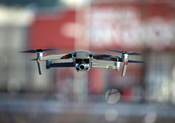 FILE PHOTO: A drone flies as Chinese drone maker DJI demonstrates their app...