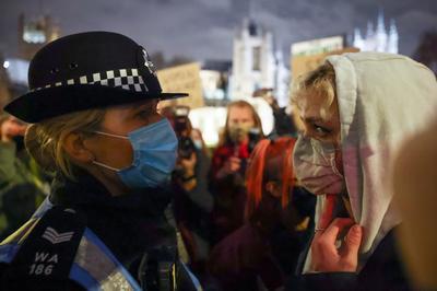 London police face backlash after dragging mourners at Sarah Everard vigil