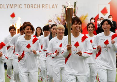 Olympic torch relay kicks off under shadow of COVID