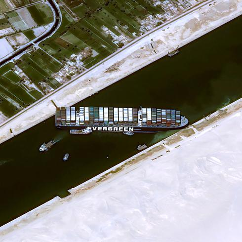 Suez Canal suspends traffic as ship stuck like 'beached whale'