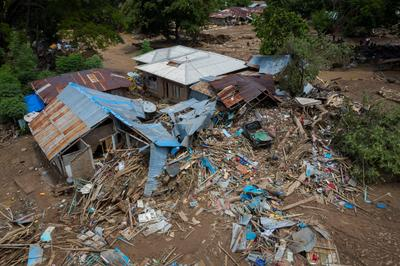 Rescuers hunt for survivors after deadly cyclone slams Indonesia